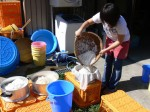 Soaked barley transferred to steamer basket - Making miso - Gaijin Farmer